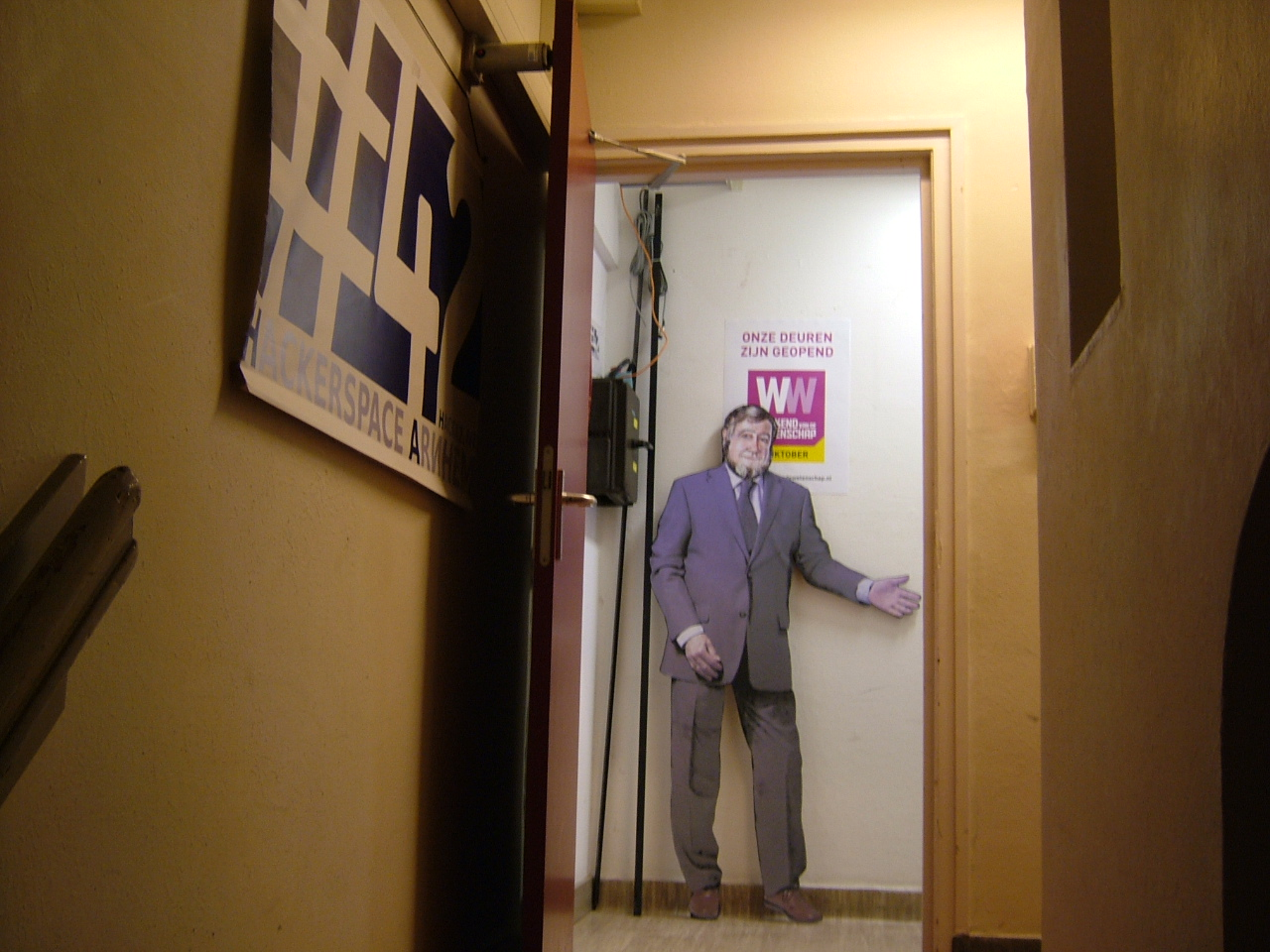 Cutout of bearded man standing in a doorway